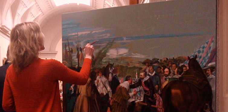 "The copyist Ana Gulias painting ""The surrender of Breda"" of Velazquez in the Prado Museum."